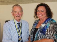 Derek Vincent receives his Paul Harris Award from ADG Sharon Woodings